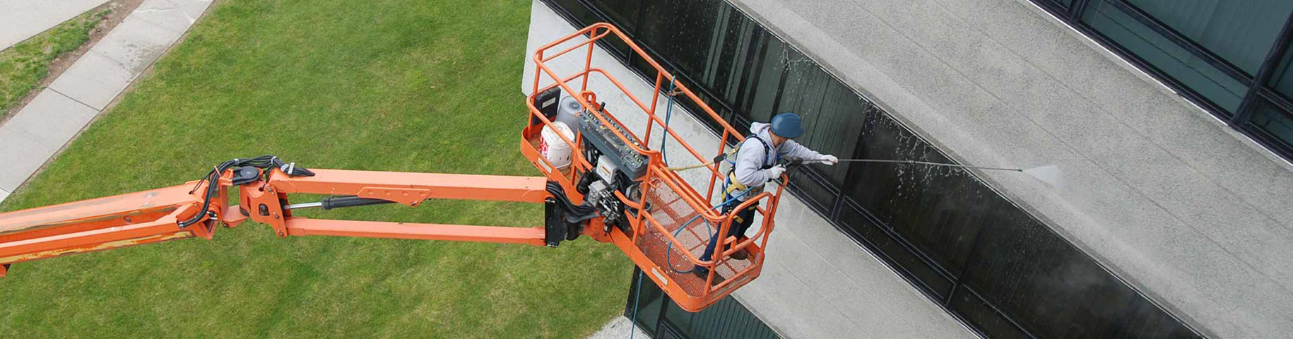 Man on Lift Powerwashing