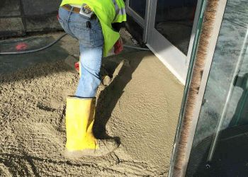 50 Connell Man Spreading Concrete