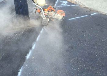 Eisenhower Parkway Man Milling Pavement